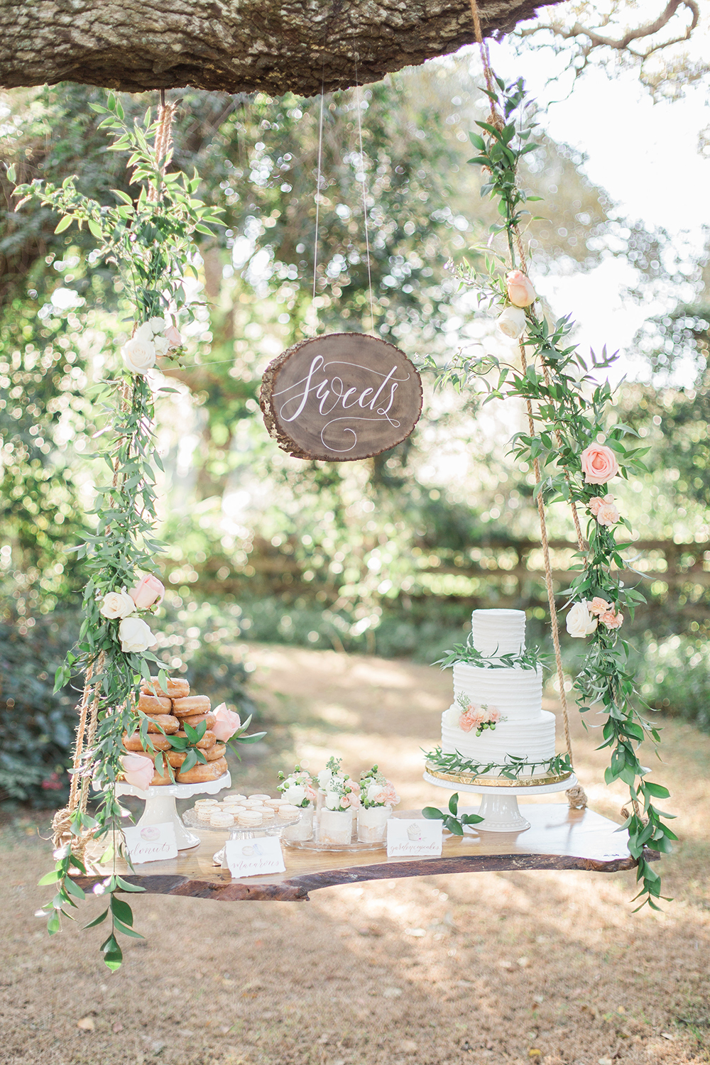 cake displays - photo by Landon Hendrick Photography http://ruffledblog.com/southern-garden-chic-wedding-inspiration
