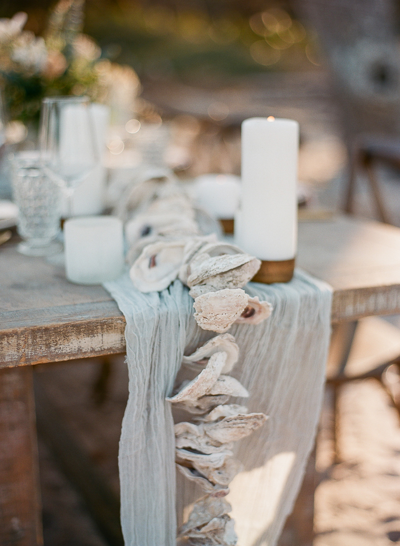 unique beach wedding table runners - photo by The Ganeys http://ruffledblog.com/intimate-wedding-inspiration-on-driftwood-beach