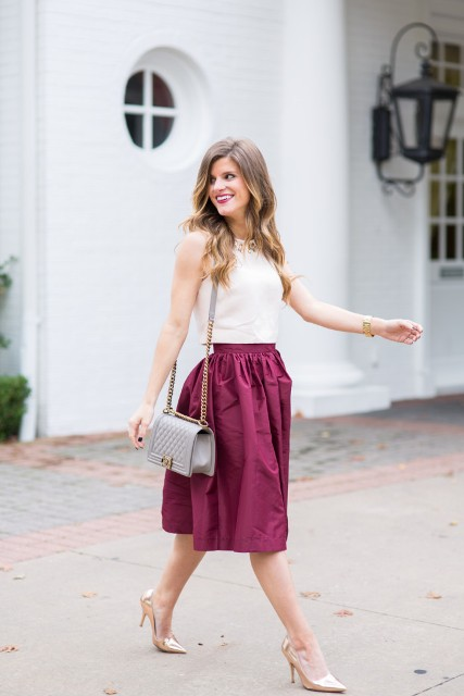 With white top, gray bag and metallic shoes
