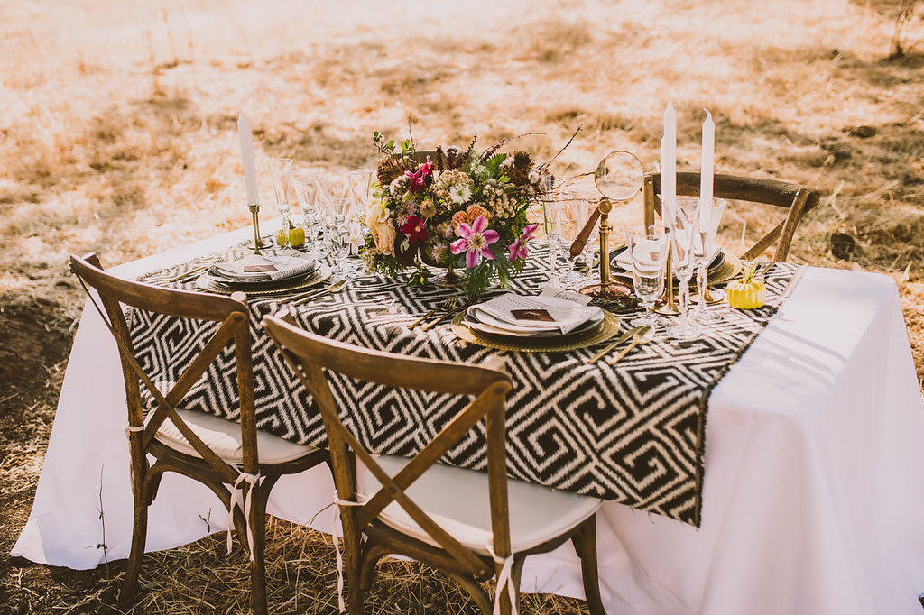 patterned tablescapes - photo by Michelle Roller http://ruffledblog.com/wild-safari-inspiration-shoot-with-a-jeep