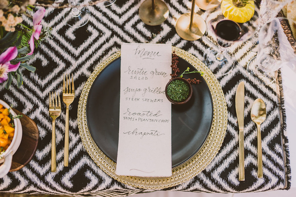 place settings - photo by Michelle Roller http://ruffledblog.com/wild-safari-inspiration-shoot-with-a-jeep