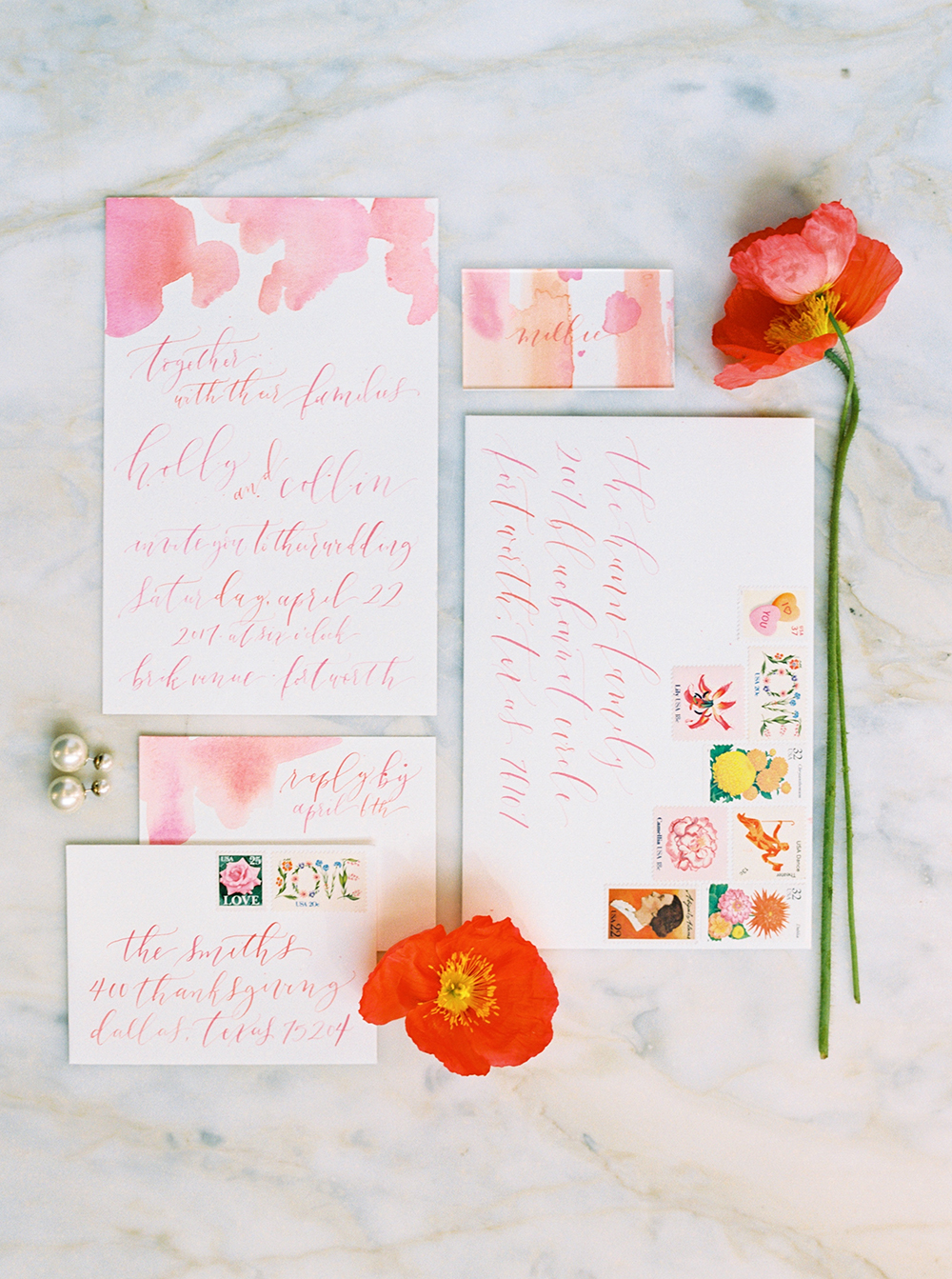 floral watercolor wedding invitations - photo by Jessica Gold Photography http://ruffledblog.com/vibrant-summer-wedding-inspiration-with-fun-colors