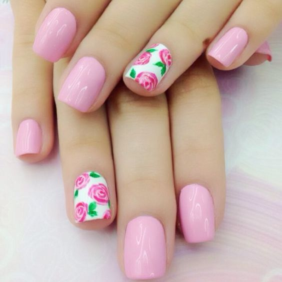 bold pink nails with accent pink roses