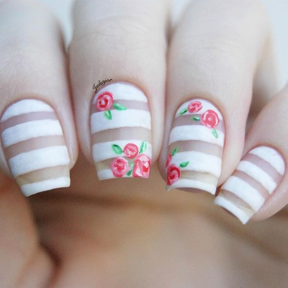 matte negative space striped nail art with red roses