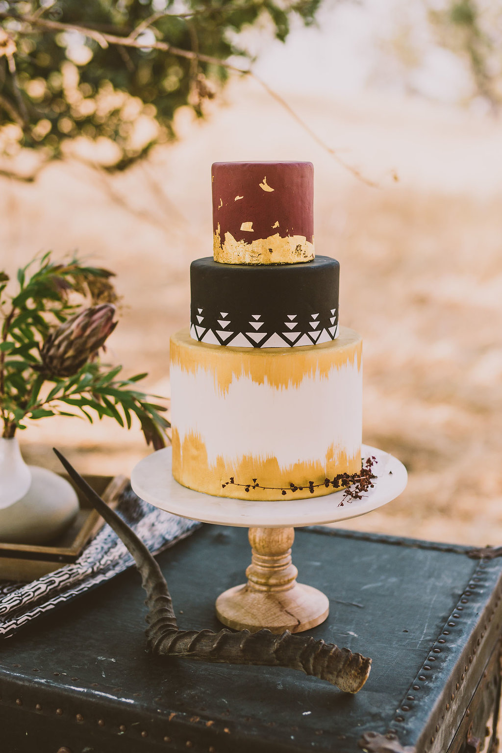 painted wedding cake - photo by Michelle Roller http://ruffledblog.com/wild-safari-inspiration-shoot-with-a-jeep