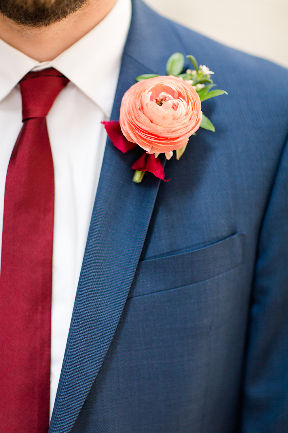 peachy pink boutonnieres - photo by Lauren Lee Photography http://ruffledblog.com/modern-grecian-inspired-wedding-ideas