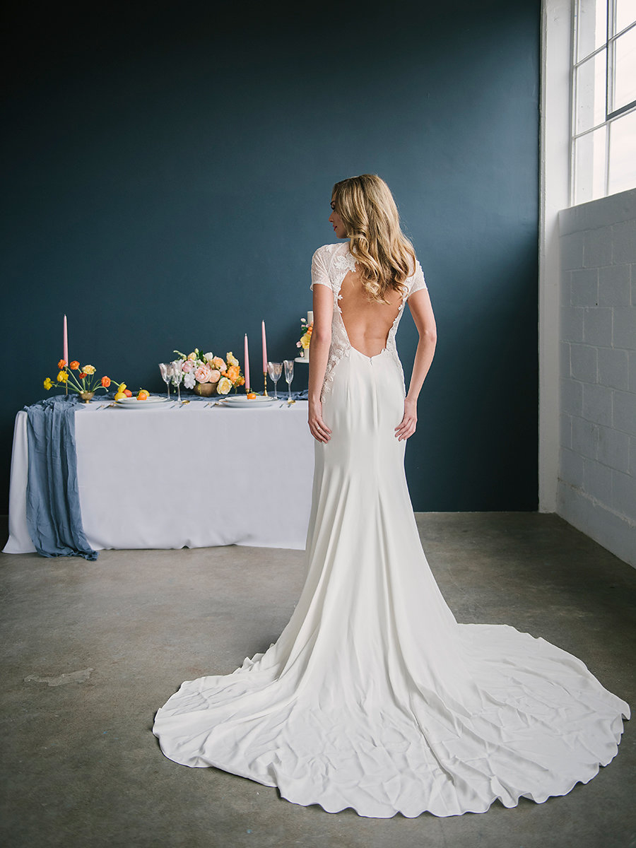 wedding dress back - photo by Ashlee Brooke Photography http://ruffledblog.com/summertime-citrus-wedding-inspiration