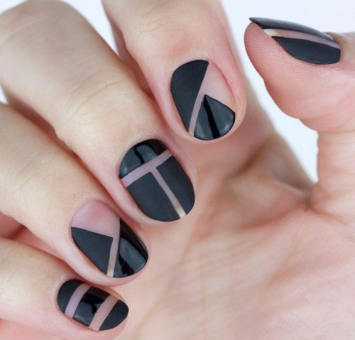 black geometric negative space nails with mismatching patterns