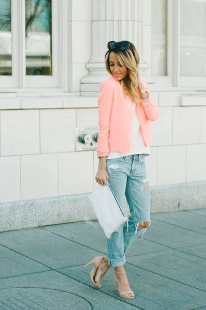 With white shirt, distressed jeans, sandals and white clutch