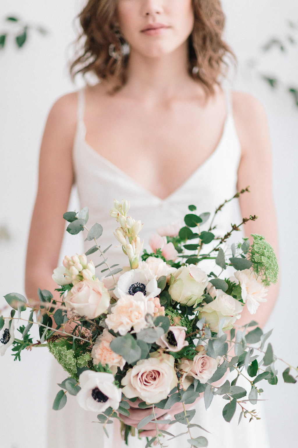 romantic anemone bouquets - photo by Julien Bonjour Photographe http://ruffledblog.com/airy-industrial-wedding-inspiration-for-spring