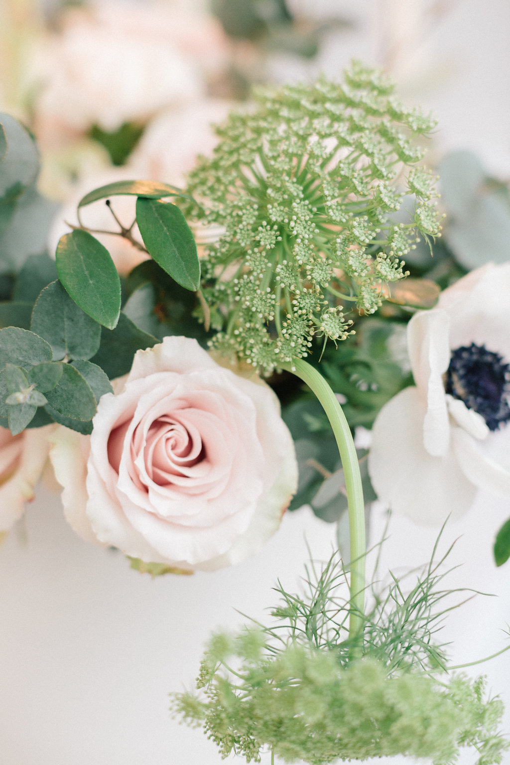 floral centerpieces - photo by Julien Bonjour Photographe http://ruffledblog.com/airy-industrial-wedding-inspiration-for-spring