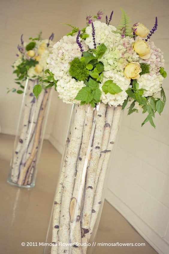 birch sticks in tall vases and fresh flowers on top for cool compositions