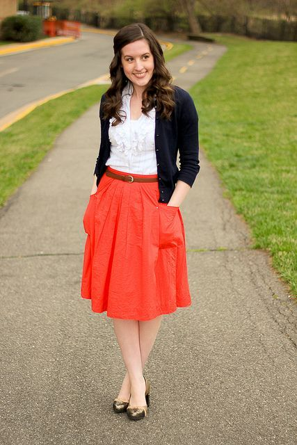 With white blouse, black cardigan, belt and shoes
