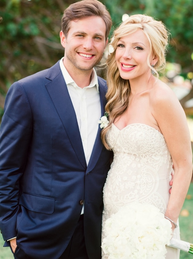The bride was wearing a strapless crochet lace wedding gown and the groom was in a navy suit with no tie