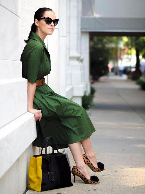 With green midi dress and yellow and black bag