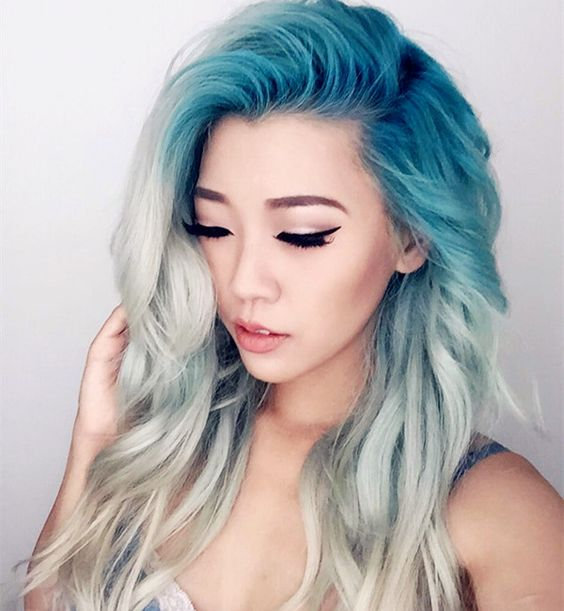 turquoise roots and white hair look incredible