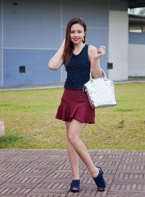With navy blue top, navy blue sandals and metallic bag