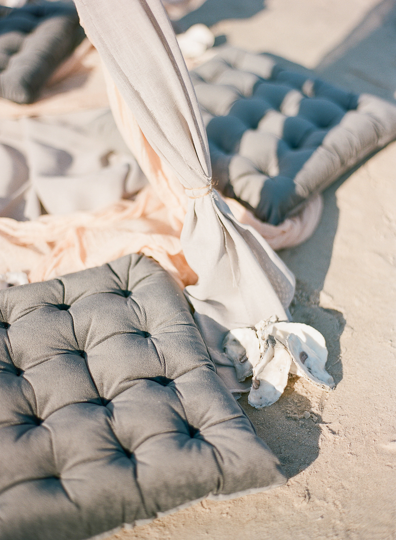 beach wedding seating - photo by The Ganeys http://ruffledblog.com/intimate-wedding-inspiration-on-driftwood-beach