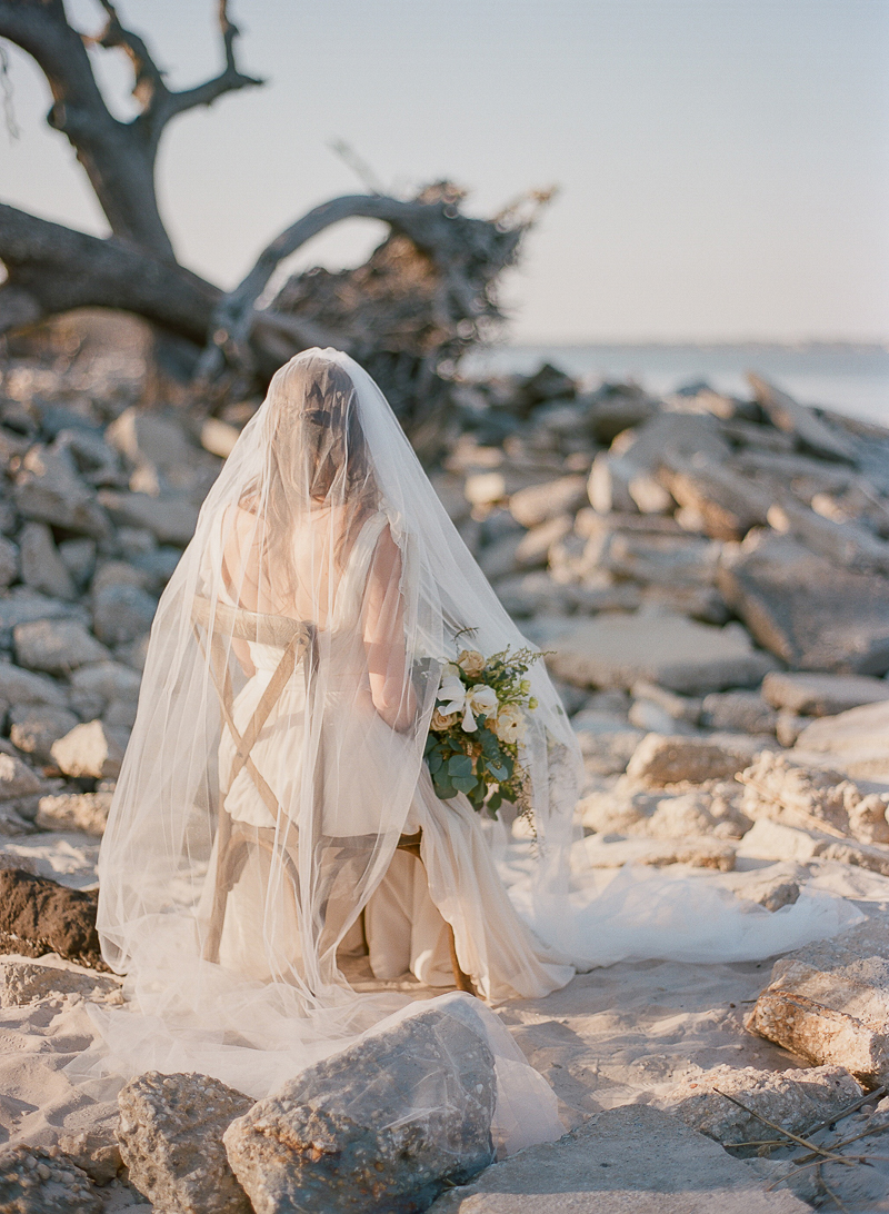 romantic beach bridal portraits - photo by The Ganeys http://ruffledblog.com/intimate-wedding-inspiration-on-driftwood-beach