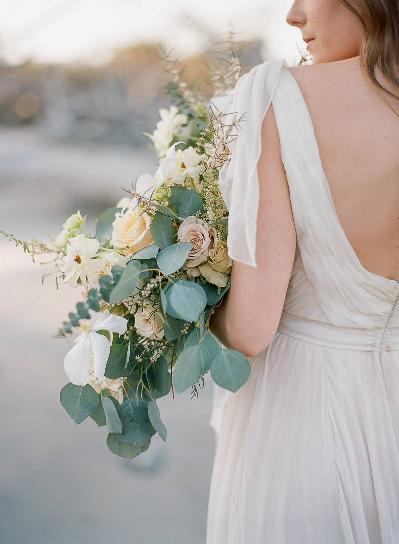 dusty rose bouquet with eucalyptus - photo by The Ganeys http://ruffledblog.com/intimate-wedding-inspiration-on-driftwood-beach