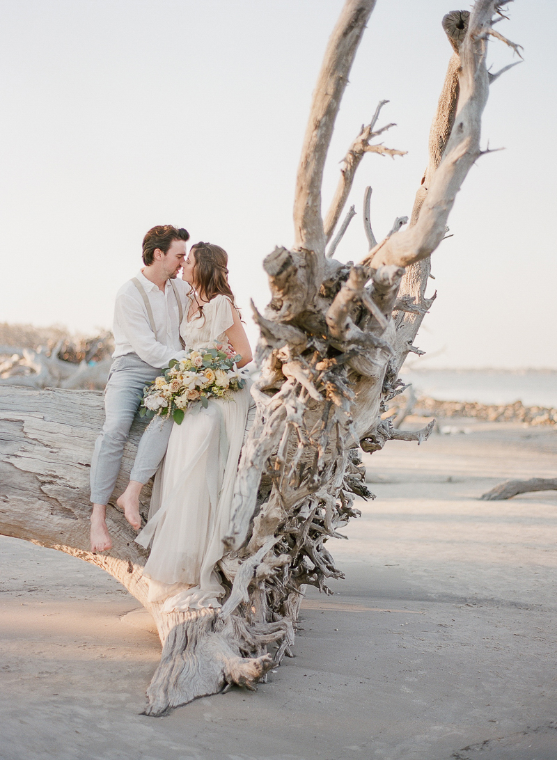 driftwood beach wedding photographs - photo by The Ganeys http://ruffledblog.com/intimate-wedding-inspiration-on-driftwood-beach