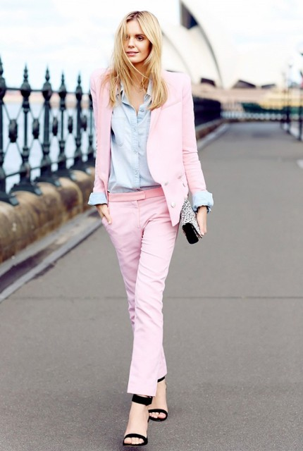 With light blue shirt, pale pink trousers, black sandals and leopard clutch