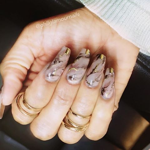 nude marble nails with gold accents