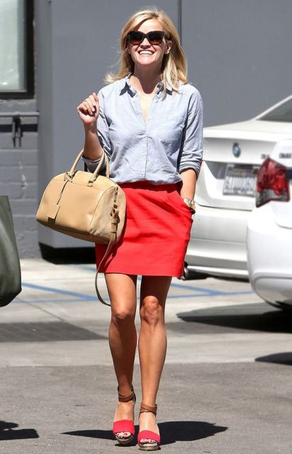 With button down shirt, beige bag and two color sandals