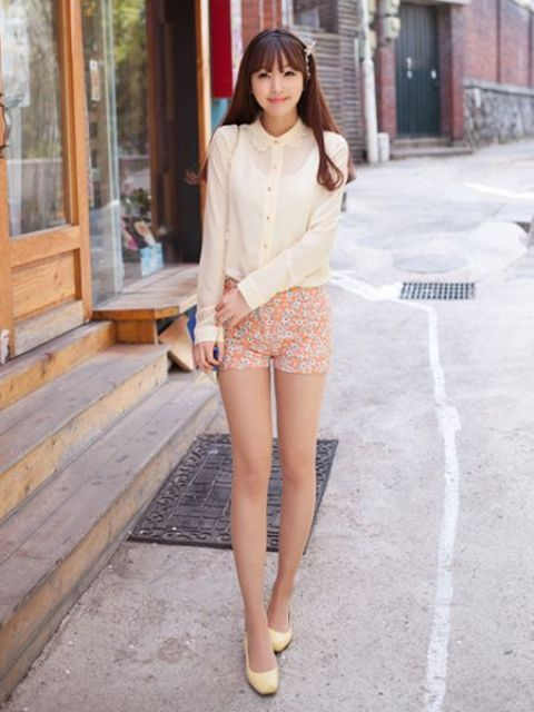 an ivory long sleeve shirt, retro pink shorts and nude flats