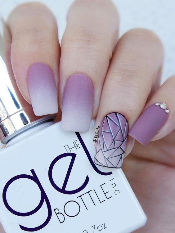 purple pink matte nails with an accent geometric one
