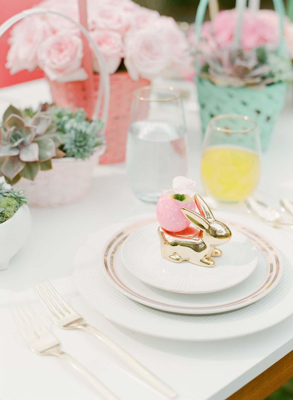 Easter place settings - photo by The Happy Bloom http://ruffledblog.com/happy-bright-easter-party-inspiration