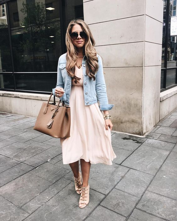 a blush dress, a distressed denim jacket and lace up heels