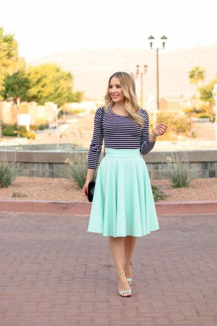 With striped shirt, mint green sandals and black bag