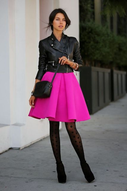 With leather jacket, black bag and platform shoes
