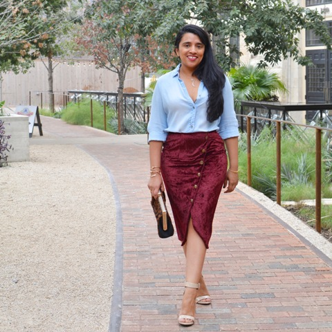 With light blue shirt, sandals and clutch