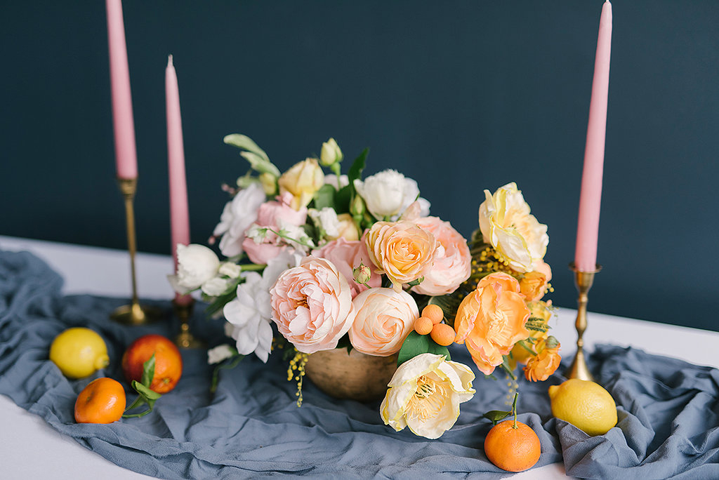 paper flower centerpieces - photo by Ashlee Brooke Photography http://ruffledblog.com/summertime-citrus-wedding-inspiration