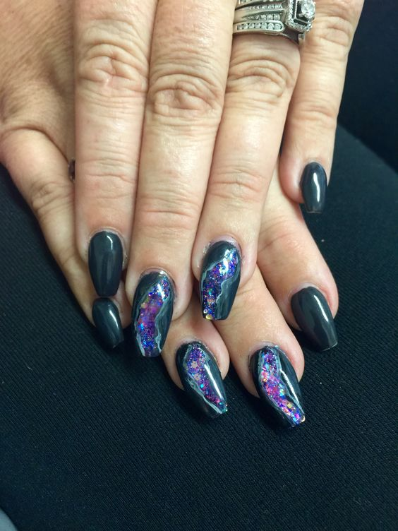 black nails with several amethyst nails