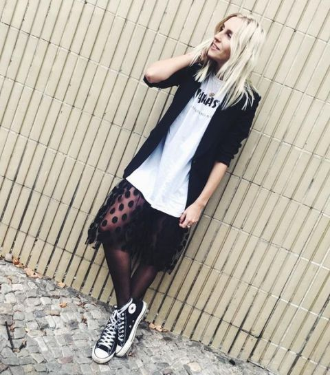 With white long t-shirt, black blazer and sneakers