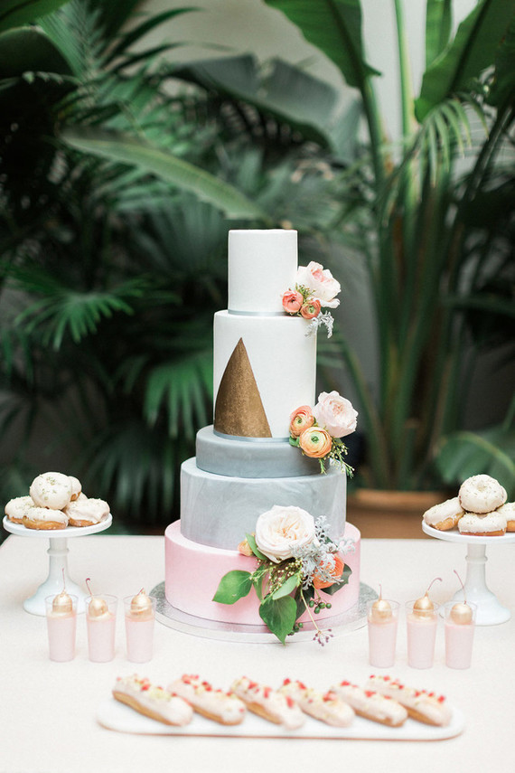 The wedding cake was a multi-tiered one, with marbelized layers and a triangle