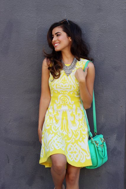 With necklace and green bag