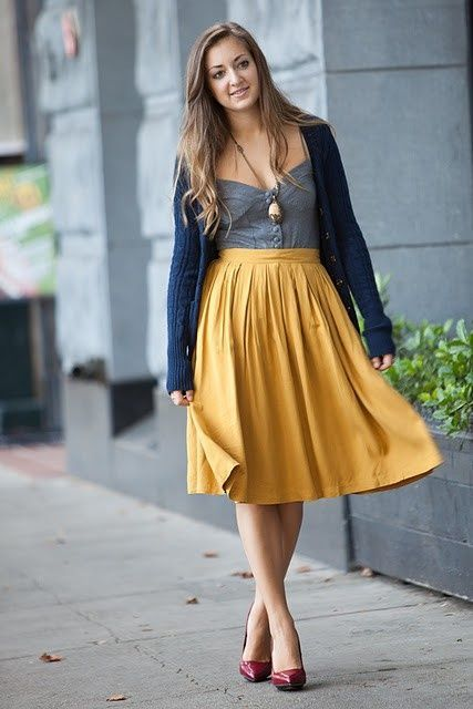With gray top, navy blue cardigan and marsala shoes