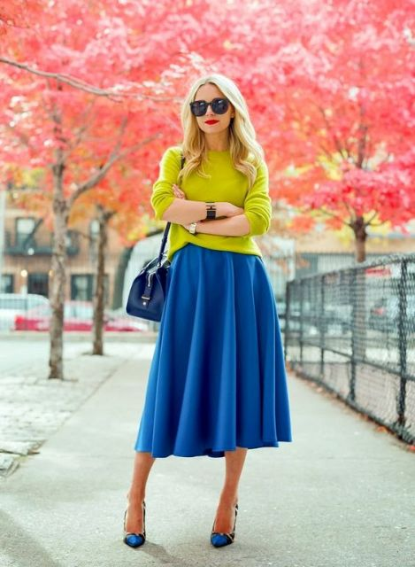 With neon green shirt, printed shoes and blue bag