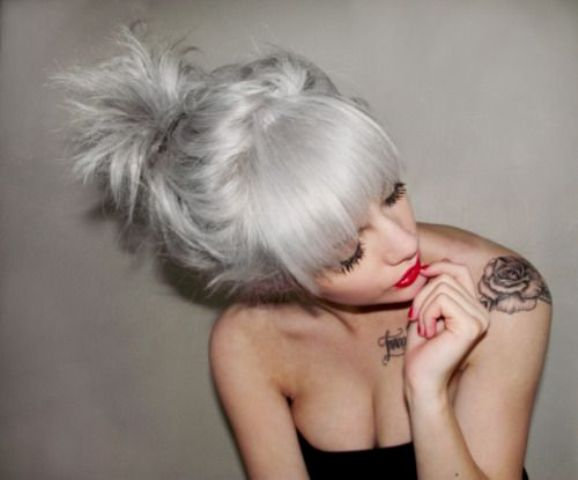 grey blonde hair, a large fringe and an updo