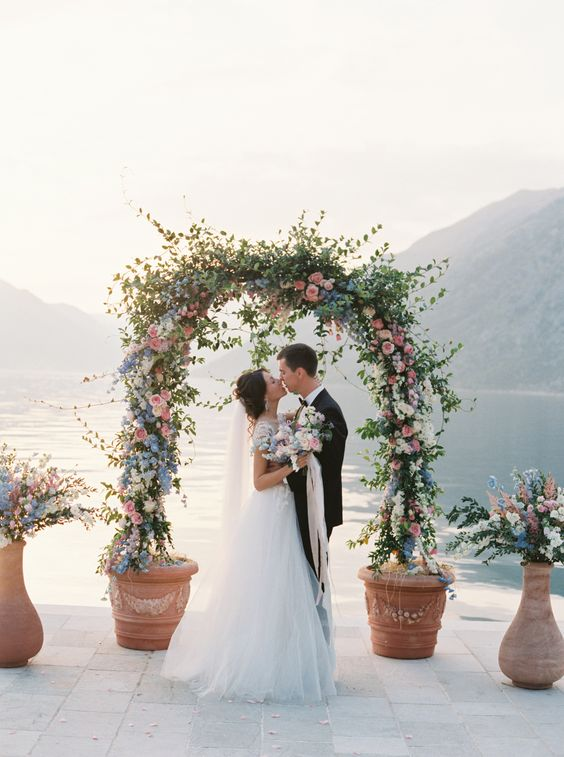gorgeous leaves, pink and blue floral arch looks breathtaking