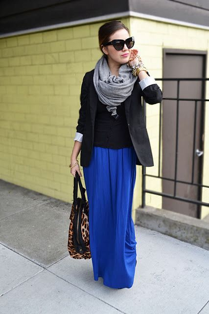 With black shirt, black jacket, gray scarf and leopard bag