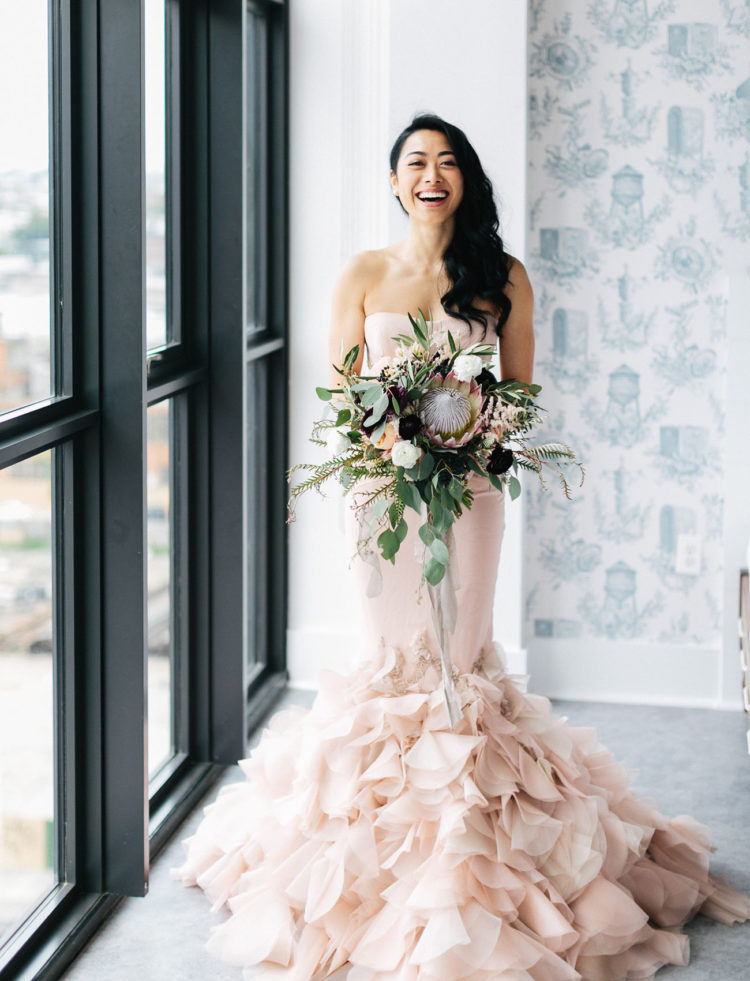 The bride chose a stunning blush Holly gown and her bouquet perfectly complemented the look