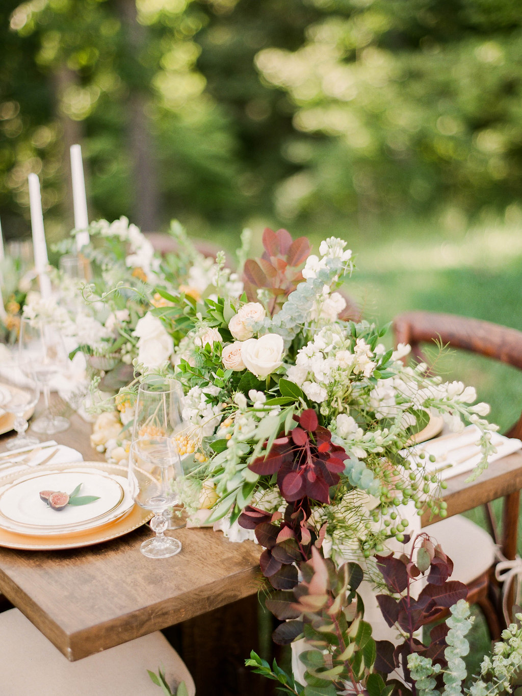 floral table runners - photo by Shannon Duggan Photography http://ruffledblog.com/elegant-chateau-wedding-inspiration-in-st-louis