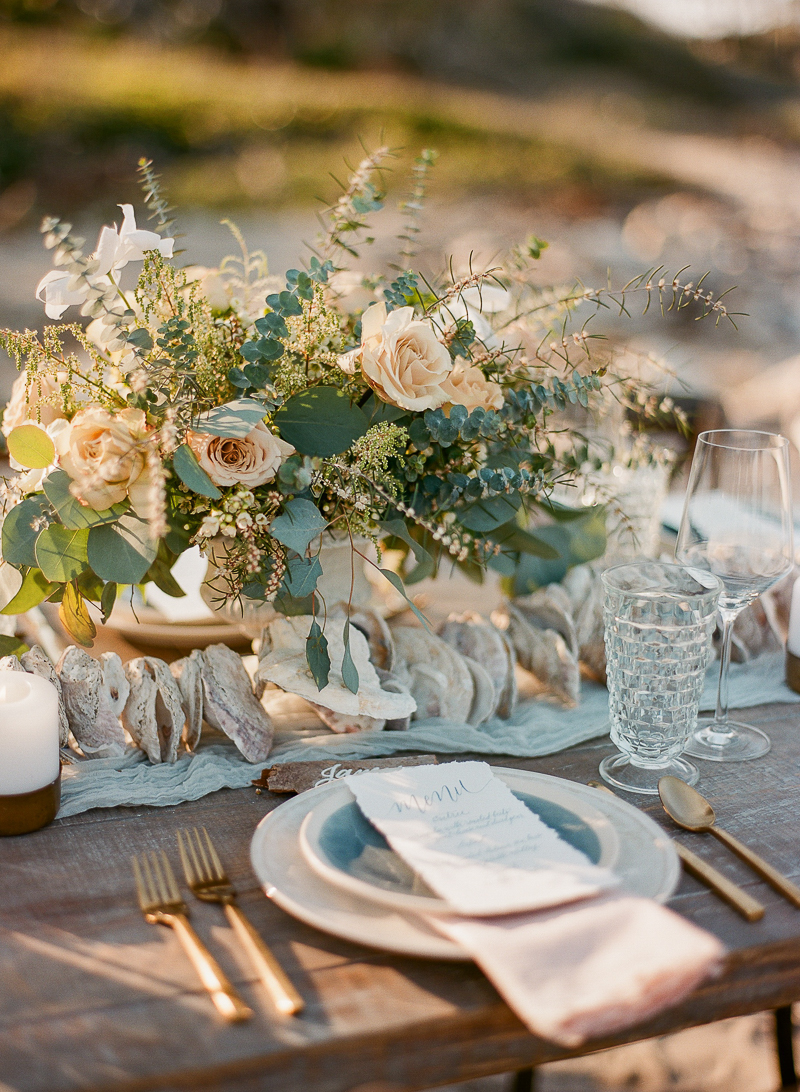 romantic wedding tables - photo by The Ganeys http://ruffledblog.com/intimate-wedding-inspiration-on-driftwood-beach