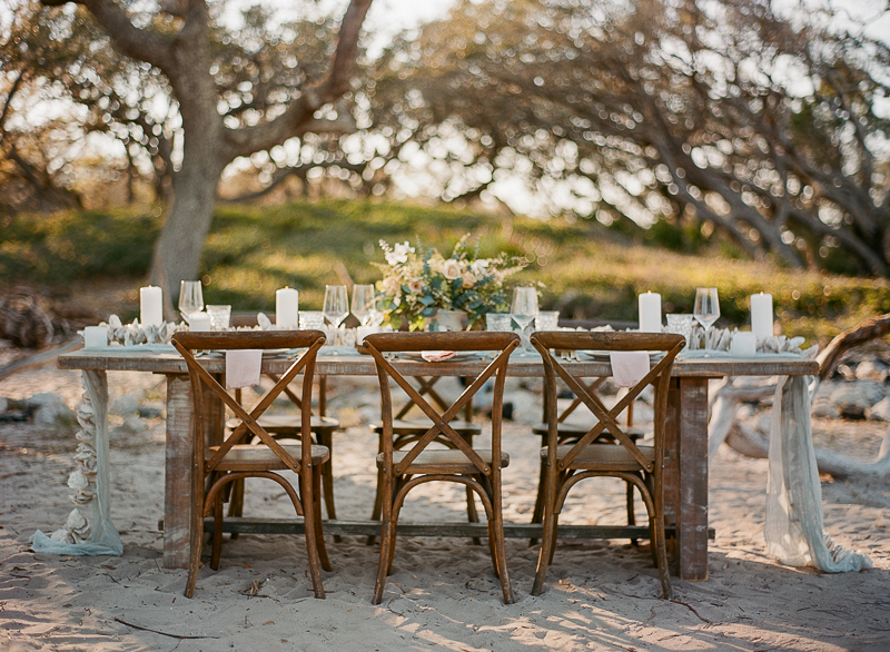 wedding tables - photo by The Ganeys http://ruffledblog.com/intimate-wedding-inspiration-on-driftwood-beach