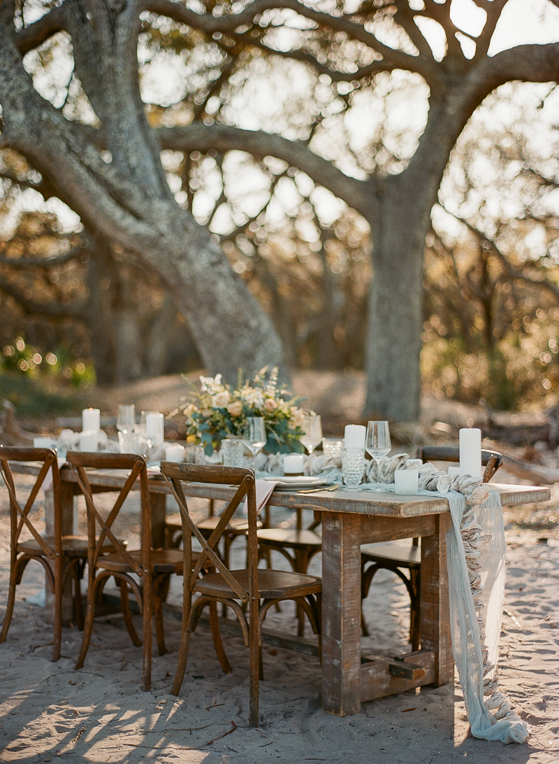 beach wedding receptions - photo by The Ganeys http://ruffledblog.com/intimate-wedding-inspiration-on-driftwood-beach